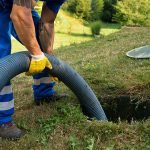man pumping a septic tank